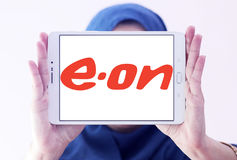 Eon energy company logo. Logo of energy and home services company eon on samsung tablet holded by arab muslim woman royalty free stock photos