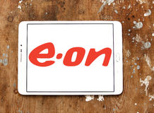 Eon logo. Logo of energy and home services company eon on samsung tablet on wooden background royalty free stock photo