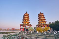 Eople come to merit at Cih Ji Dragon and Tiger Pagodas on lotus pond in sunset time. Kaohsiung, Taiwan - December 3, 2018: People come to merit at Cih Ji Dragon stock image