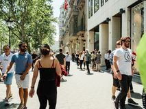 Eople on street crowd in central Barceona. BARCELONA, SPAIN - JUN 1, 2018: People on street crowd in central Barcelona european boulevard with long perspective royalty free stock images