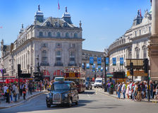 Eople and traffic in Piccadilly Circus in London. Stock Images