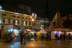 eople visit Christmas Fair in old town at evening Stock Images