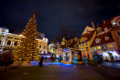eople visit Christmas Fair in old town at evening Royalty Free Stock Photo