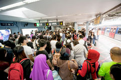 Eople waiting for delay MTR train while Typhoon Mujigae moving o Stock Photography