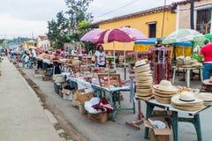Eople walk along souvenir stalls in Vinales. VINALES, CUBA - FEB 17, 2016: People walk along souvenir stalls in Vinales stock image