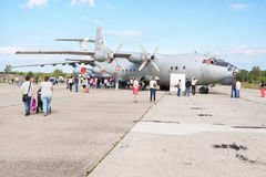 Eople watch the planes. TVER, RUSSIA - AUGUST 16, 2014: People watch the planes at the open day at the airport Migalovo stock photography