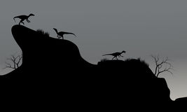 Eoraptor in cliff silhouette at night Stock Photography