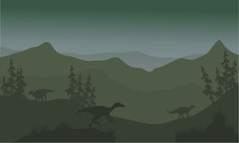 Eoraptor del dinosaurio en colinas Foto de archivo libre de regalías