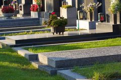 Eoropean graveyard in evening light. Gravestones in eoropean graveyard in evening ligh Stock Images