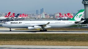 EP-MMT Mahan Air, Airbus A340-300. EP-MMT is rolling for take-off on runway 35R at Istanbul Ataturk Airport LTBA, November 6, 2018 royalty free stock image