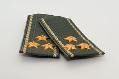 Epaulets Colonel. Closeup on a white background Stock Image