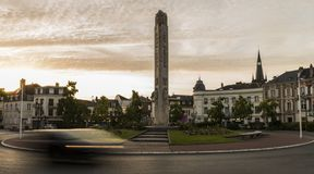 Centre Epernay. Epernay, France - June 13, 2017: Centre of Epernay with car on roundabout and statue of the war during sunset in Epernay, France Royalty Free Stock Images