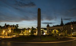 Centre Epernay Night. Epernay, France - June 13, 2017: Centre of Epernay with car on roundabout and statue of the war during sunset in Epernay, France Stock Images