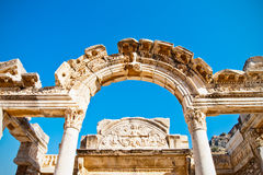 Ephesus arched doorway. Ancient Ephesus temple of Hadrian arched doorway and remains of architectural facade details, Turkey Stock Photography