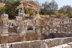Ephesus EFES, TURKEY – SEPTEMBER 8, 2016-The Fountain of Trajan was built to the north side of Curetes Street. Ephesus EFES, TURKEY – SEPTEMBER 8, 2016 Royalty Free Stock Photography