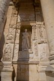 Ephesus EFES, TURKEY – SEPTEMBER 8, 2016-Marble statue personification of wisdom Sophia. Placed in the marble niche onto the ancient Roman building the stock image