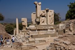Ephesus EFES, TURKEY – SEPTEMBER 8, 2016-The Memmius Monument on of Ephesus street. The figures still visible in the monument are of Memmius and his father Royalty Free Stock Image