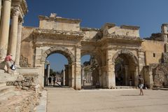 Ephesus EFES, TURKEY – SEPTEMBER 8, 2016-Tourists toward to the Gate of Augustus in Ephesus. Was built to honor the Emperor Augustus and his family. Here is Royalty Free Stock Photography