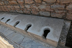 Ephesus Latrine. The latrine at the ancient city of Ephesus, located in southwest Turkey Stock Images