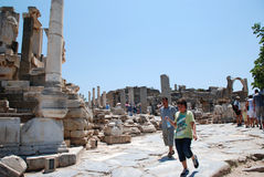 Ephesus, near Izmir, Turkey. Tourists visiting the ancient city of Ephesus, near Izmir, Turkey Royalty Free Stock Photos