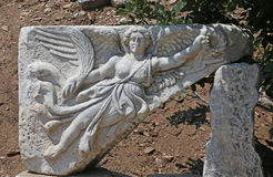 Ephesus Nike. A stone carving of the goddess Nike, who is the goddess of victory in Greek mythology.  The relief is found in the ancient city of Ephesus in Stock Photo