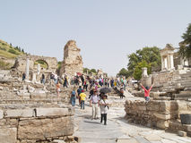 Ephesus ruins, Turkey. Unidentified tourist visiting greek-roman ruins on May 18, 2013 in Ephesus,Turkey. Ephesus was famed for the Temple of Artemis one of the Stock Photo