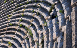 Ephesus Theater Fragment. Fragment of the theater in Ephesus, Turkey, with weeds on the rows Stock Photography