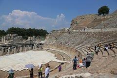 Ephesus Theatre Tourists. EPHESUS, TURKEY - AUGUST 10, 2015: Tourists in theatre in the ancient city of Ephesus, located in southwest Turkey Royalty Free Stock Photos