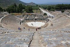 Ephesus Theatre. EPHESUS, TURKEY - AUGUST 10, 2015: Tourists in theatre in the ancient city of Ephesus, located in southwest Turkey Stock Photography