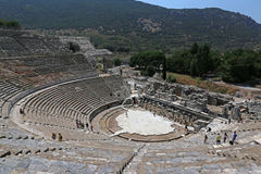 Ephesus Theatre View. EPHESUS, TURKEY - AUGUST 10, 2015: Tourists in theatre in the ancient city of Ephesus, located in southwest Turkey Royalty Free Stock Images