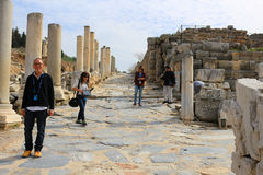 Ephesus, Turkey. FEBRUARY 17, 2016: Tourists walk down the marble walkway in  in the Middle East Royalty Free Stock Photos