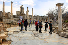 Ephesus, Turkey. FEBRUARY 17, 2016: Tourists walk down the marble walkway in  in the Middle East Royalty Free Stock Images