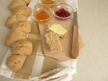 Epi baguette with honey and jam Stock Images