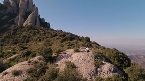 Trail running in mountains. Epic action shot from aerial drone of two active strong sportsman or athletes doing trail running training or race on amazing stock video