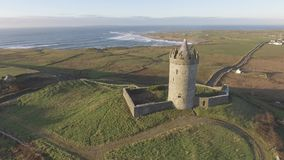 Epic Aerial Scenic Irish Castle landscape view from Doolin in County Clare. Famous tourist attraction along the wild atlantic way stock video footage