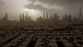 Epic aerial view of the urban landscape, with large skyscrapers and the sun breaking through the clouds. Dubai, UAE. Sun rays from behind the clouds illuminating stock video