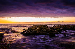 Epic Afterglow Sunset. Strange looking set of rocks nearby the shoreline during a  sunset with an epic afterglow in Marmara sea of the country Turkey. Early Royalty Free Stock Photos