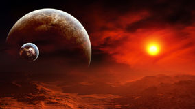 Epic Alien Planet Burning Sky. Majestic sunset in a distant planet with two moons on its horizon and the burning atmosphere Stock Image