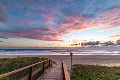 Epic beach landscape with sunrise sky and beach entrance. Of wooden deck, bridge Royalty Free Stock Photos