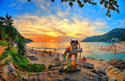 Epic Beach Sunset with Buddha Temple. A great unique beach in Thailand on sunset with holiday makers around and in the water. and a little Buddha Temple in the Royalty Free Stock Photos