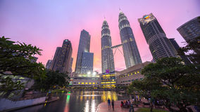 Epic and Beautiful Sunset at Kuala Lumpur City Centre. Water Fountain at Suria KLCC with Petronas Towers and Office Buildings at Blue Hour sunset at Night. It's Stock Photo