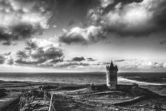 Epic black and white Doolin Castle in County Clare, Ireland. sce. Nic irish countryside along the wild atlantic way Stock Photography