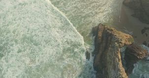 Epic Cliff and Ocean Waves Top View stock footage