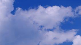 Epic clouds over blue sky background. Timelapse shot.