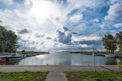 Epic clouds over small port Royalty Free Stock Photo