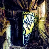 Epic colorful graffiti in old psych center. Very cool and colorful picture of graffiti in a old abandonded psych center Royalty Free Stock Image