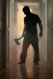 Epic concept with man holding axe inside a smoking house Royalty Free Stock Photography