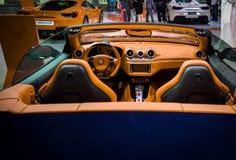 Epic convertible luxurious sports Ferrari car - Beautiful orange Ferrari interior royalty free stock images