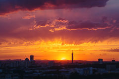 Epic Dramatic Sunset Sky in Industrial City Stock Photo