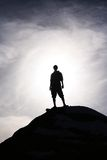 Epic Hero. A hero silhouetted in victory Stock Photos